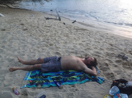 Sun bathing on a beach in Hawaii